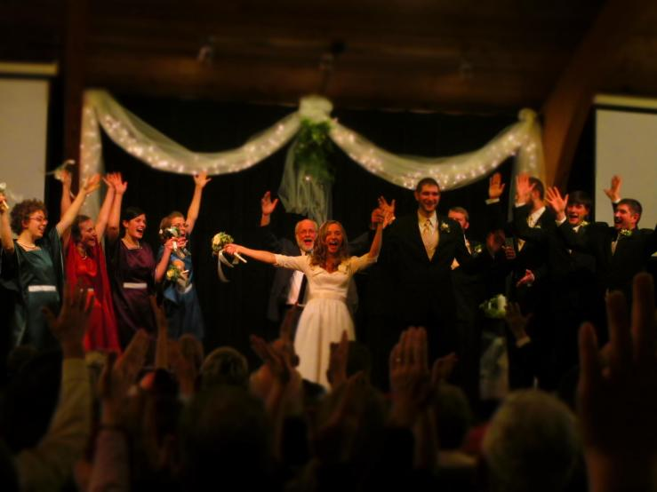 "After the pronouncement, every one cried ""Ta-da"" at the bride's request. Photo by Amy Bahe."