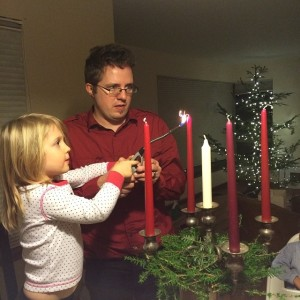 Our granddaughter Sarina lights the candle of hope with her dad Christian on December 1, 2013.