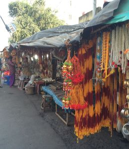Tokens of devotion for sale along the road in Kalighat Temple in Calcutta.